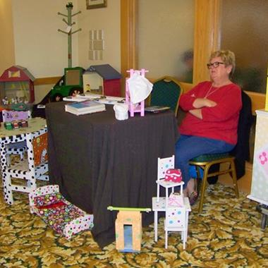 A vendor at the craft fair- She was selling doll furniture that her husband made and she painted.  Very cute!